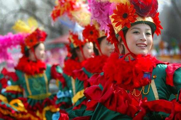 A-Chinese-girl-performs-a-dance-in-a-park-during-the-Chinese-Lunar-New-Year